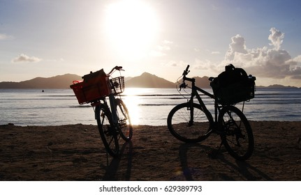 Bicycle silhouette on a wild beach in Seychelles on Praslin island