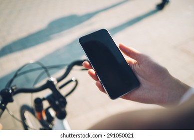 Bicycle and smartphone in hand