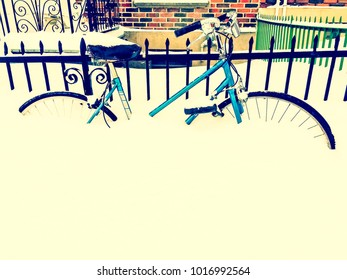 Bicycle in snow, after snowstorm, near an urban building. Retro style photo.