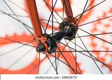 Bicycle spokes detail closeup. Detail view with hub and spokes of orange bicycle wheel.
