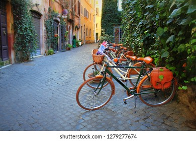 Bicycle standing in front of store on old street of Rome .