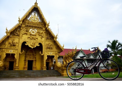 Bicycle stop at front of gold ubosot or golden church at Wat Sri Pan Ton is ancient temple for people visit and pray in Nan, Thailand