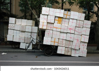 Bicycle with styrofoam boxes is overloaded on Chinese street