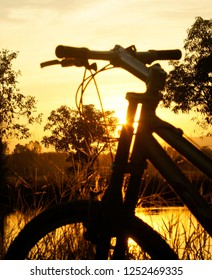 Bicycle and sunset in tropical