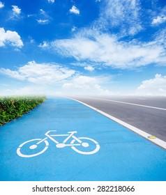 bicycle symbol lane on blue sky background.