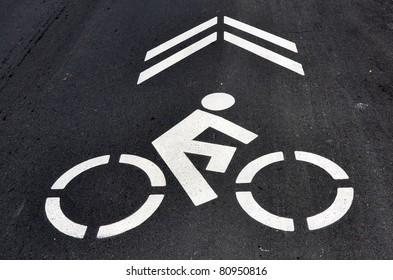 Bicycle symbol on asphalt street