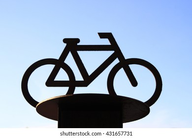 A bicycle symbol under the blue sky