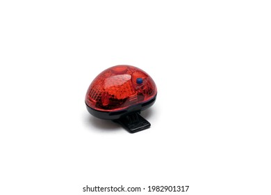 Bicycle taillight. Used bicycle taillight on an isolated white background. Selective focus. Space for text