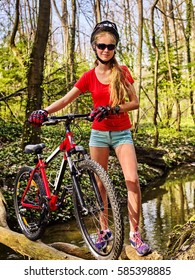 Bicycle teen with ladies bikes in summer park. Womens road bike for running on nature. Girl cycling fording throught water . Cycling trip is good for health.