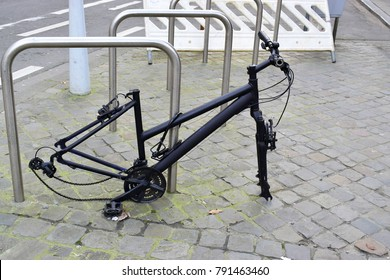 Bicycle theft on the street in the city, wheel stolen and only bike with padlock left on the street. Very difficult for take care when your bike in town.