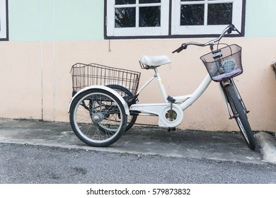 bicycle three wheels parking at home., disable concept.