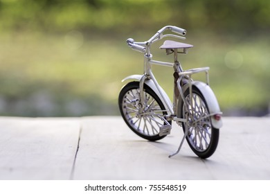Bicycle toy models on wooden floor with sunshine