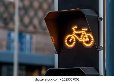 Bicycle traffic light switched to yellow colour
