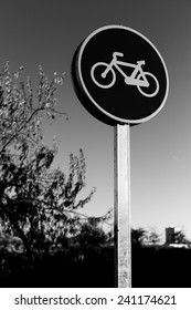 A bicycle traffic signal in vertical composition on black and white.