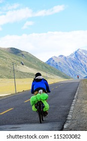Bicycle trip on Tibet snow mountain