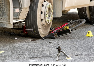 Bicycle under tyre of truck. Car and bike crash accident