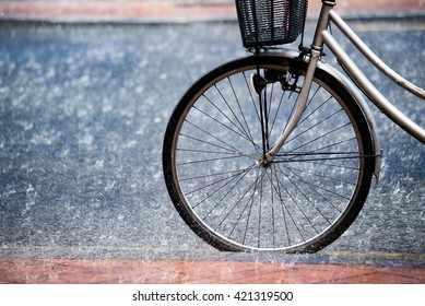 Bicycle wheel on the street under the rain