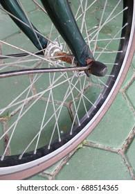 bicycle wheel with rusty hub.