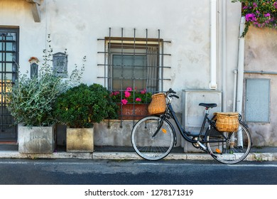 Bicycle with wicker baskets on the street in Orbetello on peninsula in Argentario in Tuscany. Italy