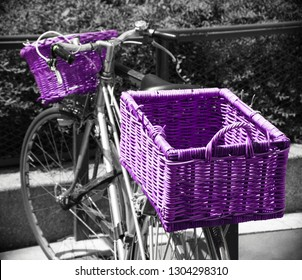 Bicycle with wicker baskets parked near park in Paris (France). fence Urban healthy lifestyle. Ecologic transport concept.  Retro toned violet black white photo. Vintage background.