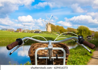 Bicycle and windmill. Symbols of the Netherlands. Tourism, bicycle tour, travel concept.