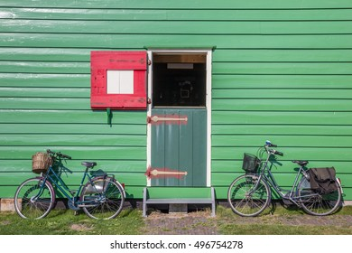 Bicycles in front of a green wooden house in Zaanse Schans, Netherlands