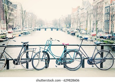 Bicycles lined up on bridge in Amsterdam