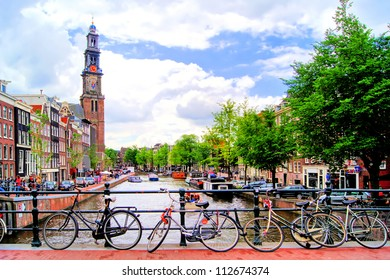 Bicycles lining a bridge over the canals of Amsterdam, Netherlands