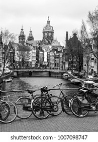 Bicycles on a bridge in Amsterdam, Netherlands. Black and white image.