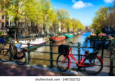 Bicycles on a bridge over the Keizersgracht Canal in Amsterdam, Holland