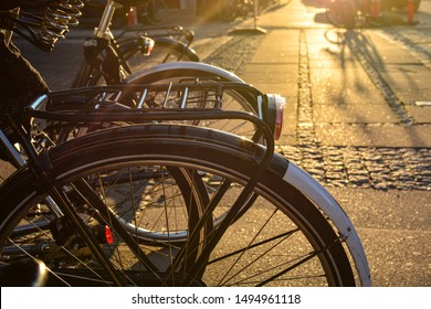 Bicycles on a street of Copenhagen, Denmark. Colorful old town architecture the sunset. Copenhagen style, European street, Denmark bicycle