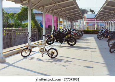 Bicycles in the park is filled with motorcycles.