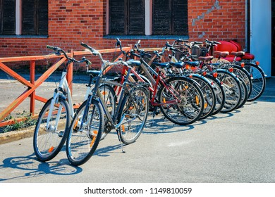 Bicycles parked in Nida resort town near Klaipeda in Neringa on the Curonian Spit and the Baltic Sea in Lithuania.