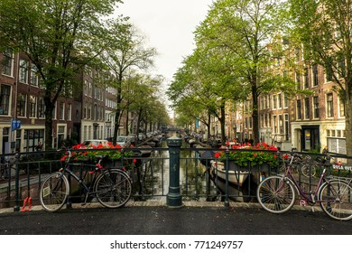 Bicycles parked on a bridge over Bloemgracht canal, Amsterdam, September 2017