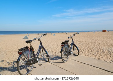 Bicycles parked on a sandy beach in Hoek Van Holland, The Netherlands