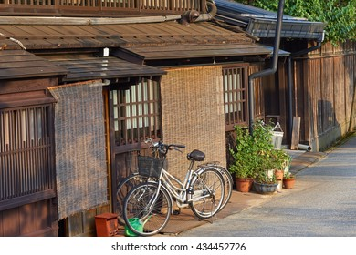 Bicycles parked outside of traditional residential town houses in Takayama city, Japan