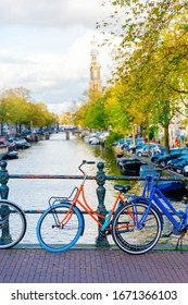 bicycles parking at the railing of a bridge in Amsterdam, Netherlands