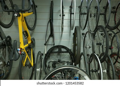 Bicycles and wheels hung on the wall / Bicycle shop and accessories concept