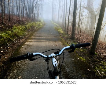 Bicycling along the greenway in the forest on a foggy morning at Tims Ford State Park in Winchester Tennessee