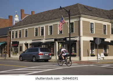 Bicyclist rides through historic Concord, MA outside of Boston, Memorial Day, 2011