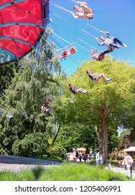 BIDDINGHUIZEN, NETHERLANDS, MAY 31, 2014: People on chain carousel in an amusement park Walibi Holland during a sunny day