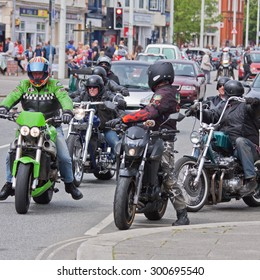 BIDEFORD, ENGLAND - MAY 30, 2015: An unidentified group of participants take to the road at the town's Bike Show which is held annually to support local charities and attracts around 2,000 motorcycles
