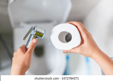 Bidet shower or toilet paper. Close up.