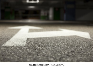 A bi-directional arrow symbol. From the ground level. Shallow depth of field.