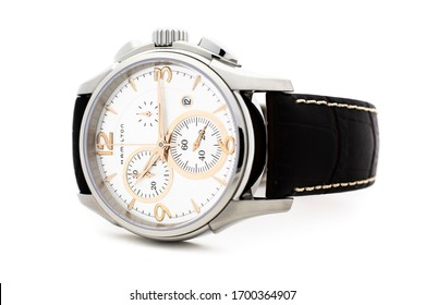 Biel, Switzerland 31.03.2020 - The close up of Hamilton man watch stainless steel case white clock face dial leather strap swiss quartz mechanical watch isolated lying on table swiss made manufacture