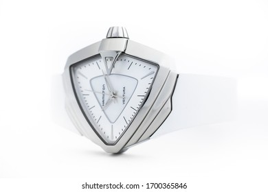 Biel, Switzerland 31.03.2020 - The close up of Hamilton woman watch stainless steel case white clock face dial rubber strap swiss quartz mechanical watch isolated lying on table swiss made manufacture