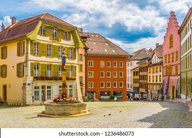 BIEL/BIENNE, SWITZERLAND, JULY 15, 2017: People are strolling through an old street in the historical center of Biel/Bienne, Switzerland