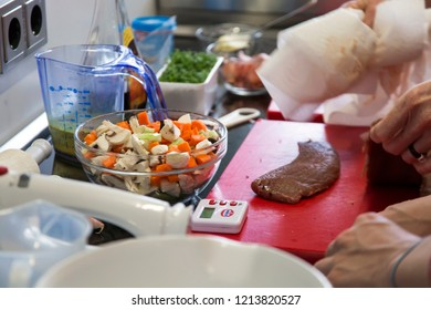 BIELEFELD, NORTH RHIJN WESTFALEN / GERMANY – APRIL 13 2017: Work place with vegetables and meat during seminare in kitchen by Dr. Oetker World.