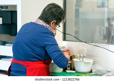 BIELEFELD, NORTH RHIJN WESTFALEN / GERMANY – APRIL 13 2017: Female course member at work during seminare in kitchen by Dr. Oetker World.