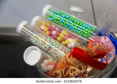 BIELEFELD, NORTH RHIJN WESTFALEN / GERMANY – APRIL 13 2017: Glass bowl with food decoration in plastic tubes and bags in kitchen by Dr. Oetker World.